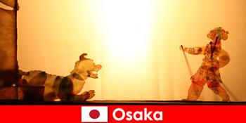 Osaka Japonia ia turiști din întreaga lume într-o călătorie comică de divertisment